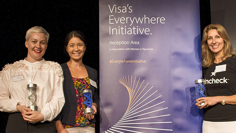Three women pose with their trophies after winning Sydney's Visa Everywhere Initiative competition.