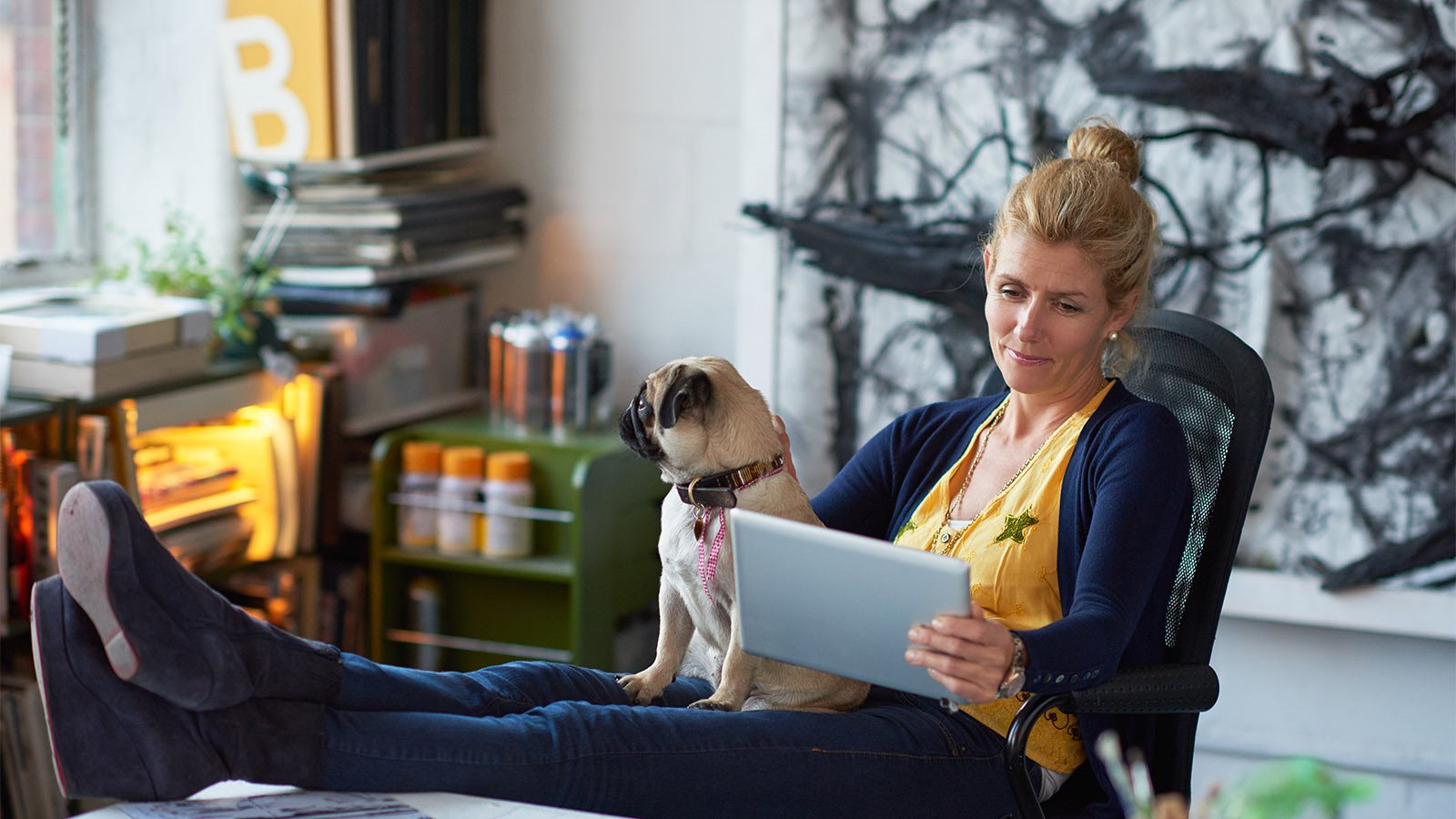 women using tablet with dog